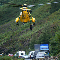 RAF and Royal Navy rescue helicopters winch stranded people from their vehicles after a landslide engulfed the A84 north of Lochearnhead<br /><br />Picture by John Lindsay.<br />Copyright Perthshire Picture Agency<br />Tel: 01738 623350  Mobile: 07775 852112
