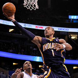 March 11, 2012; Orlando, FL, USA; Indiana Pacers shooting guard Dahntay Jones (1) shoots over Orlando Magic power forward Glen Davis (11) during the fourth quarter of a game at  Amway Center. The Magic defeated the Pacers 107-94.  Mandatory Credit: Derick E. Hingle-US PRESSWIRE