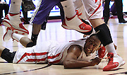 Utah guard Chris Hines falls under the feet of other players after attempting a shot during the first half of an NCAA college basketball game against Washington in Salt Lake City, Saturday, Jan. 7, 2012. (AP Photo/Colin E Braley)
