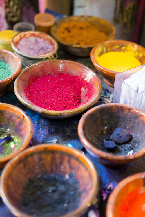 Bowls of powdered paints and pigments on a table at the dyers souk, Marrakesh, Morocco