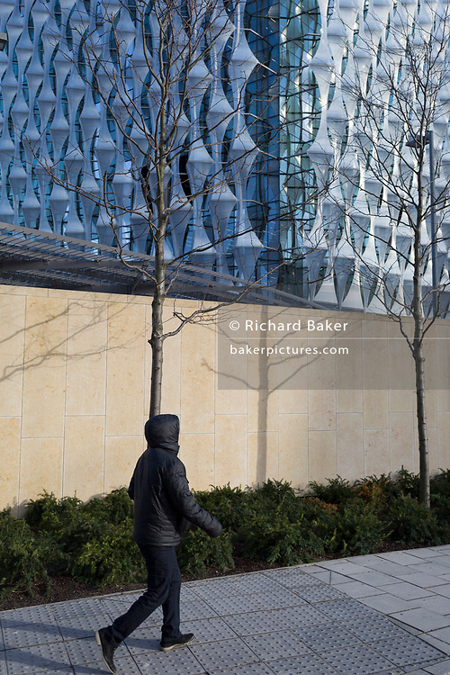 A person walks past the US Embassy at Nine Elms in south London, on 16th January 2018, in London, England. On the day when the consulate opened for public business (visa applications etc.)  after its controversial move from Grosvenor Square in central London to the south bank.