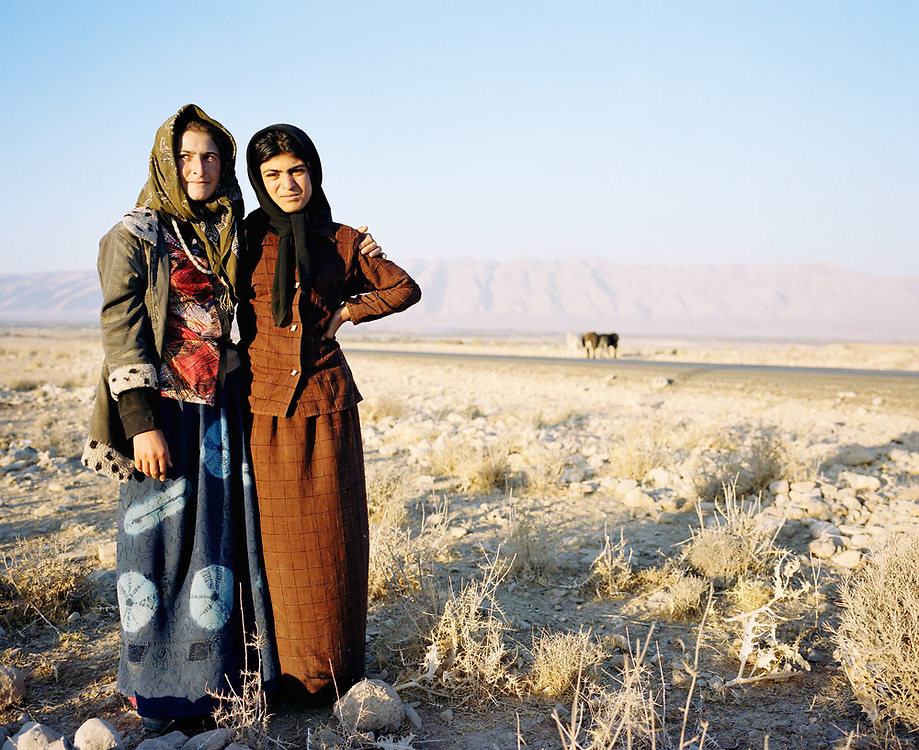 Two bedouin girls stand beside a road while herding goats on the outskirts of Shiraz, located in the southwest of Iran on 24th October 2007. .Portraits of Iranians born since the 1979 revolution.