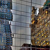 Reflections of buildings in Midtown Manhattan in windows.