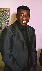Turner Prize winner, artist CHRIS OFILI, at a dinner in London on 8th March 1999.MPC 49