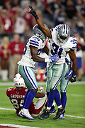 Dallas Cowboys free safety Byron Jones (31) celebrates with Dallas Cowboys rookie safety Xavier Woods (25) after breaking up a desperation fourth down pass to Arizona Cardinals tight end Jermaine Gresham (84) in the end zone during the 2017 NFL week 3 regular season football game against the against the Arizona Cardinals, Monday, Sept. 25, 2017 in Glendale, Ariz. The Cowboys won the game 28-17. (©Paul Anthony Spinelli)