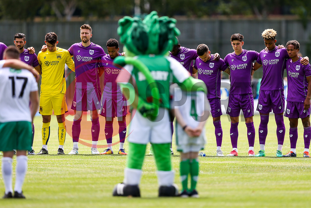 Guernsey and Bristol City (purple) players stand for a minutes silence in memory of young Sunderland Fan Bradley Lowery who sadsly lost his battle with cancer yesterday - Rogan/JMP - 08/07/2017 - Footes Lane - Guernsey - Guernsey FC v Bristol City - Pre-season Friendly.