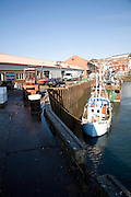 Fishing boats and sheds by the harbour, Scarborough, Yorkshire, England