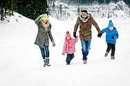 Family With Two Children, Holding Hands, Fun, Snow,
