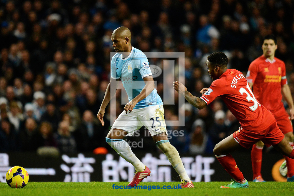Picture by Ian Wadkins/Focus Images Ltd +44 7877 568959<br /> 26/12/2013<br /> Fernandinho of Manchester City beats Raheem Sterling of Liverpool during the Barclays Premier League match at the Etihad Stadium, Manchester.