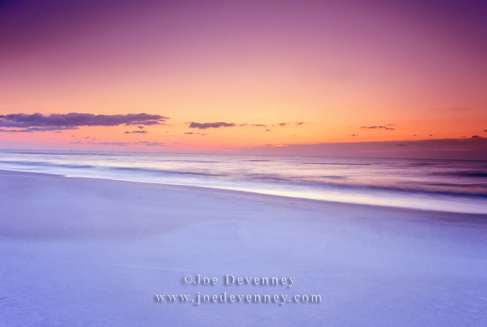 Long exposure on the beach at dawn to blur the incoming waves on the beach at Assateague Island National Seashore.