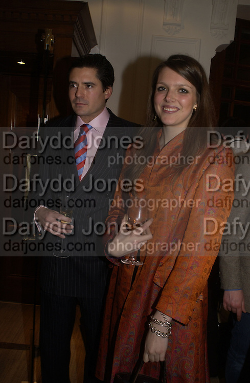 Edward Taylor and Genevieve Chapman. Charles Finch and Dr. Franco Beretta host launch of Beretta stor at 36 St. James St. London. 10  January 2006. ONE TIME USE ONLY - DO NOT ARCHIVE  © Copyright Photograph by Dafydd Jones 66 Stockwell Park Rd. London SW9 0DA Tel 020 7733 0108 www.dafjones.com