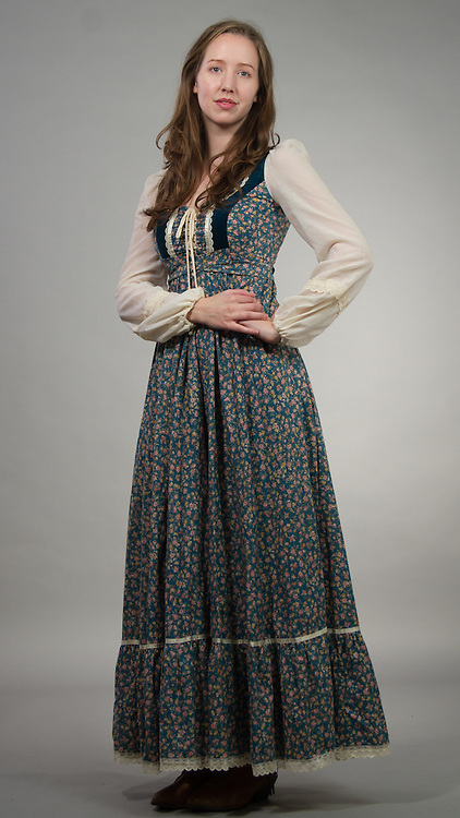 Female model posing in a western country dress.