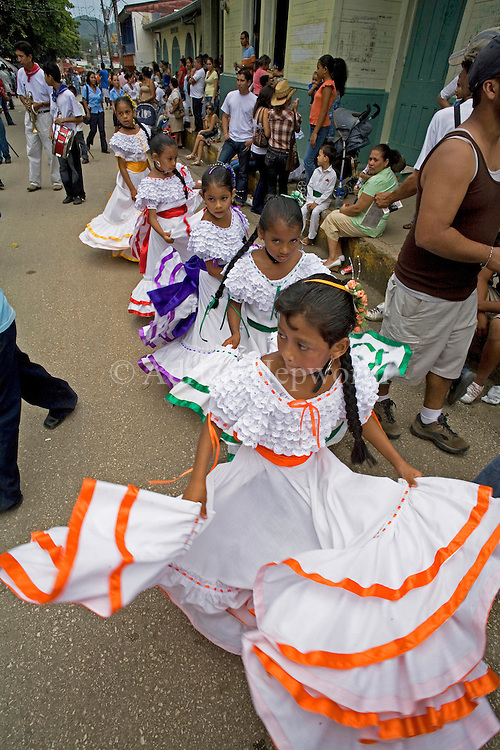 Children dancing in traditional costumes. Street parade on Guanacaste Day - 25th July, Nicoya, Guanacaste, Costa Rica.<br />