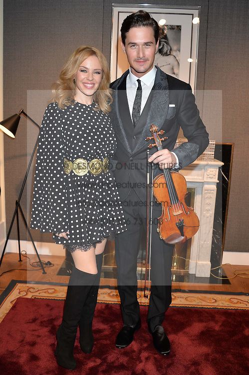 KYLIE MINOGUE and English contemporary classical violinist CHARLIE SIEM at the Dolce & Gabbana London Collections: Mens Event 2014 held at Dolce & Gabbana, 53-55 New Bond Street, London on 5th January 2014.