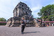 guard protecting Mendut Temple, Borobudur, Java, Indonesia, Asia
