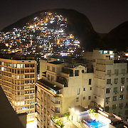 A contrast between the hotels complete with swimming pools at Copacabana beach and the favela Morro dos Cabritos just behind Copacabana beach, Rio de Janeiro, Brazil. 20th July 2010. Photo Tim Clayton