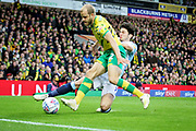 Norwich City forward Teemu Pukki (22) tackled by Blackburn Rovers defender Lewis Travis (27) during the EFL Sky Bet Championship match between Norwich City and Blackburn Rovers at Carrow Road, Norwich, England on 27 April 2019.