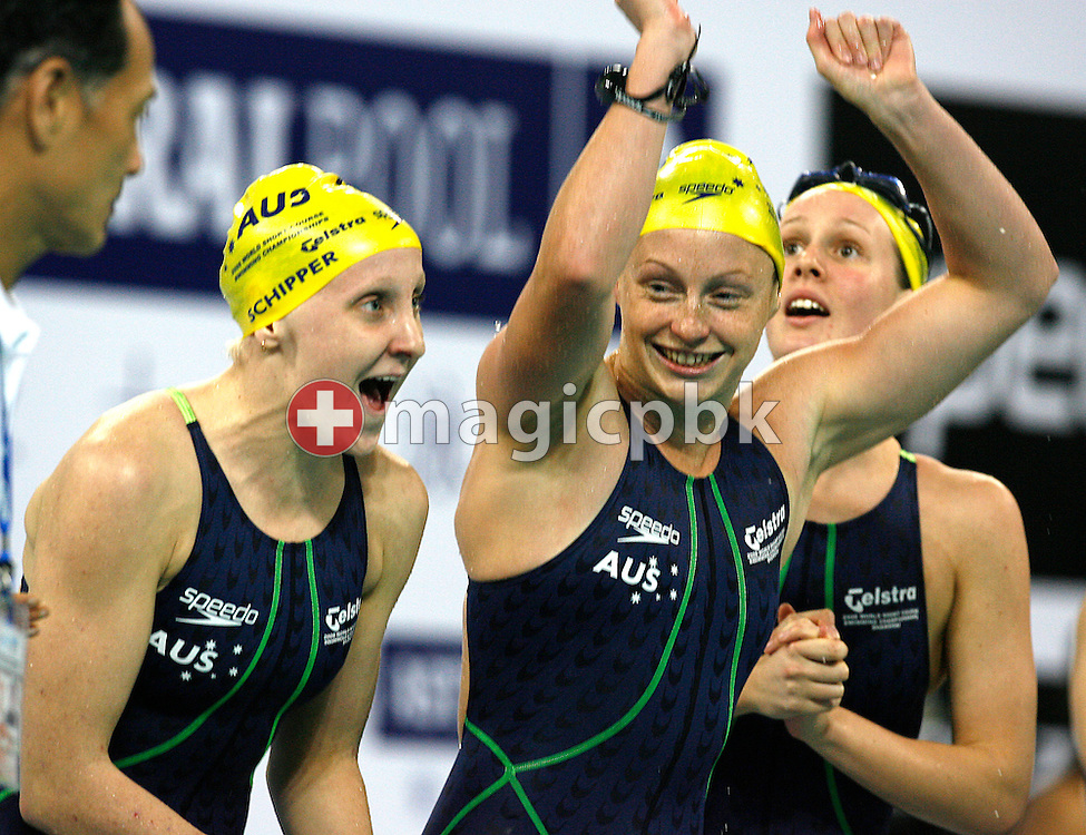 (L-R) Jessicah SCHIPPER, Shayne REESE and Bronte BARRATT of Australia cheer during the final leg of the women's 4x200 meter Freestyle relay final during day one of the 8th FINA World Swimming Championships (25m) held at Qi Zhong Stadium April 5, 2006 in Shanghai, China. Australia came from behind to win the gold medal. (Photo by Patrick B. Kraemer / MAGICPBK)