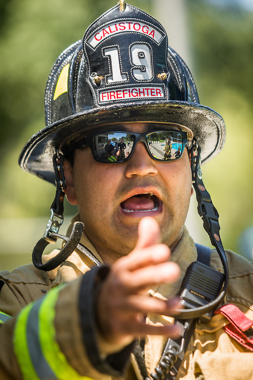 Veteran firefighter Jaime Orozco directs new recruits during hose training at the Community Pool in Calistoga.