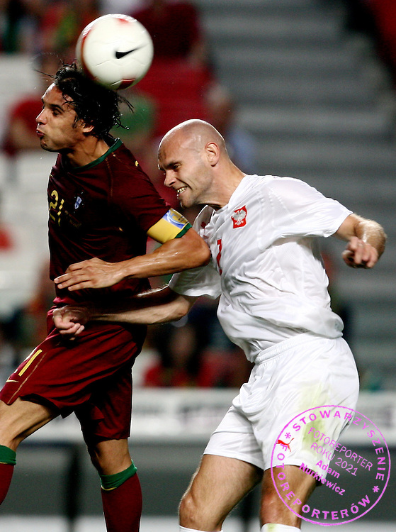 (L) NUNO GOMES (PORTUGAL) & (R) MARIUSZ JOP (POLAND)  DURING QUALIFING SOCCER MATCH EURO 2008 BETWEEN PORTUGAL AND POLAND..LISBON , PORTUGAL , SEPTEMBER 08, 2007.( PHOTO BY ADAM NURKIEWICZ / MEDIASPORT )..PICTURE ALSO AVAIBLE IN RAW (NEF) FORMAT ON SPECIAL REQUEST.