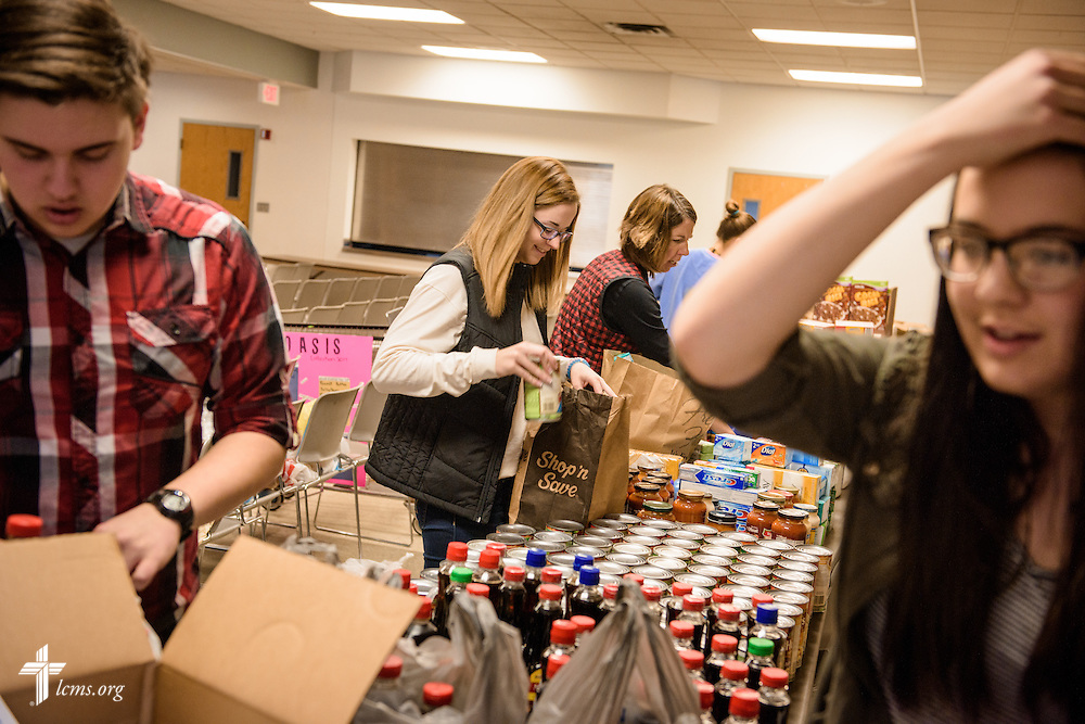 Sarah Franklin (center) helps pack food pantry items for delivery on Sunday, Feb. 26, 2017, at Immanuel Lutheran Church & School in St. Charles, Mo. LCMS Communications/Erik M. Lunsford
