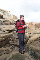 Young woman hiking in Acadia National Park. Bar Harbor Maine.