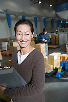 Asian woman in distribution warehouse portrait