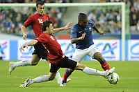 FOOTBALL - UEFA EURO 2012 - QUALIFYING - GROUP D - FRANCE v ALBANIA - 7/10/2011 - PHOTO JEAN MARIE HERVIO / DPPI - FLORENT MALOUDA (FRA) / KLODIAN DURO (ALB)