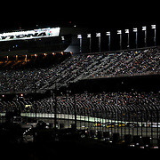 Race cars exit turn four and head down the front stretch during the NASCAR Sprint Unlimited Race at Daytona International Speedway on Saturday, February 16, 2013 in Daytona Beach, Florida.  (AP Photo/Alex Menendez)