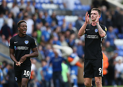 Portsmouth's goal scorers Jamal Lowe (left) and Oli Hawkins celebrate at the end of the match against Peterborough during the match at the ABAX Stadium with team mate Ronan Curtis