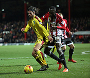 Burnley midfielder George Boyd shielding the ball from Brentford midfielder Toumani Diagouraga during the Sky Bet Championship match between Brentford and Burnley at Griffin Park, London, England on 15 January 2016. Photo by Matthew Redman.