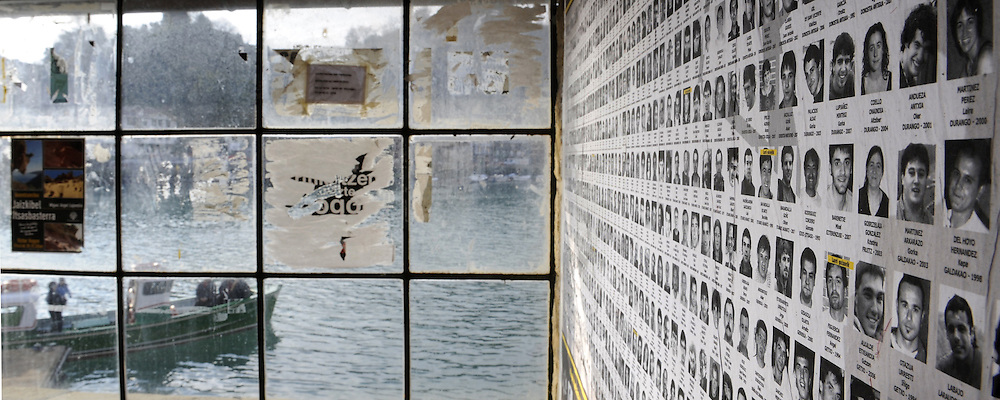Hundreds of portraits of armed Basque group ETA imprisoned members, are stuck on a wall at the port of the northern Spanish Basque village of Pasajes de San Pedro, on February 18, 2009.