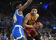 Feb 28, 2019; Los Angeles, CA, USA;Southern California Trojans forward J'Raan Brooks (33) is defended by UCLA Bruins guard David Singleton (34) in the first half at Pauley Pavilion. UCLA defeated USC 93-88 in overtime.