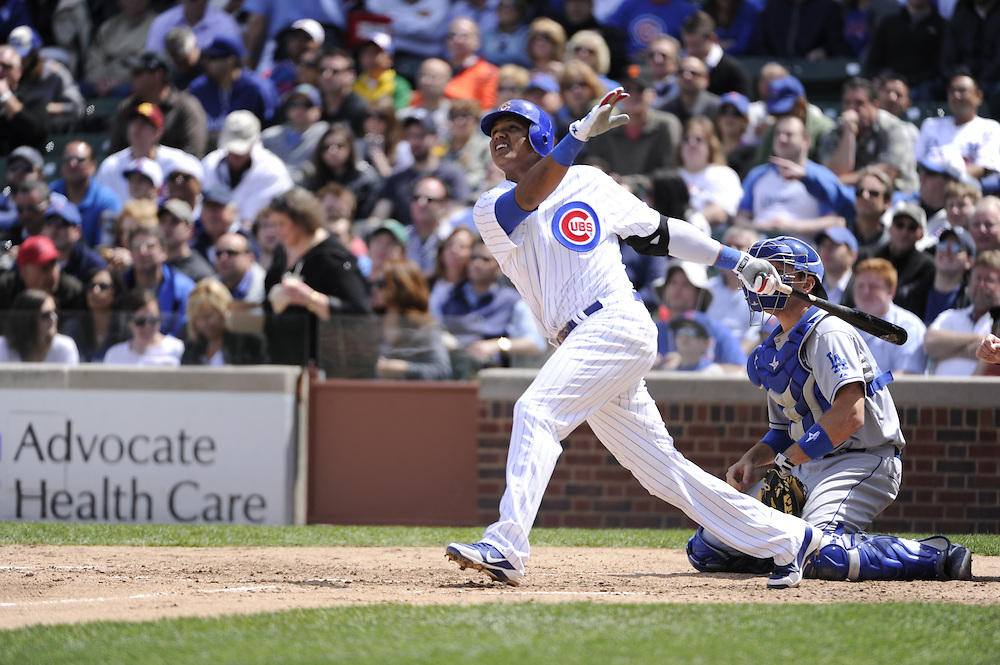CHICAGO - MAY  04:  Starlin Castro #13 of the Chicago Cubs bats against the Los Angeles Dodgers on May 4, 2012 at Wrigley Field in Chicago, Illinois.  The Cubs defeated the Dodgers 5-4.  (Photo by Ron Vesely)   Subject:  Starlin Castro