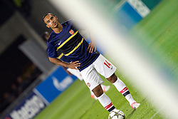 Theo Walcott warms up before the Champions League group match between Montpellier and Arsenal at the Stade la Mosson, Montpellier, France, 18th September 2012. Eoin Mundow/Cleva Media