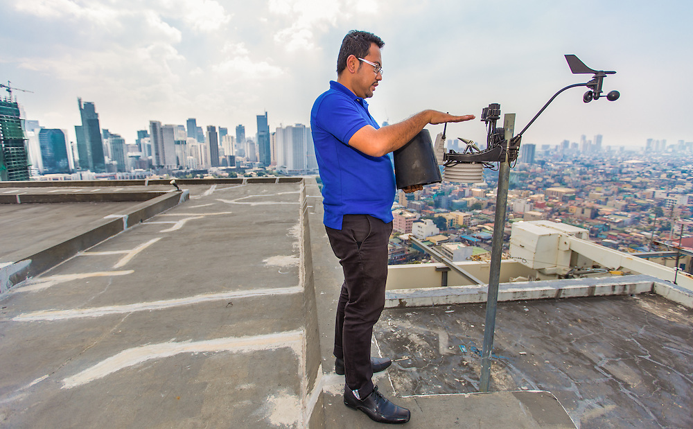 CAPTION: This is one of the tools used by the Operations and Warning Division to collect real-time data on rainfall and wind direction. It is entirely solar powered. LOCATION: Disaster Risk Reduction and Management Office, Makati, Philippines. INDIVIDUAL(S) PHOTOGRAPHED: Mark William Bocalbos.