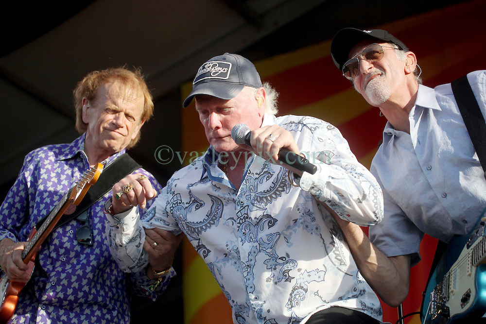 27 April 2012. New Orleans, Louisiana,  USA. .New Orleans Jazz and Heritage Festival. .The Beach Boys take to the stage to kick off their 50th anniversary tour. Al Jardine (L) and David Marks (Rt) mockingly help Mike Love (mid) get back on his feet as the band pokes fun at their ageing condition..Photo; Charlie Varley.