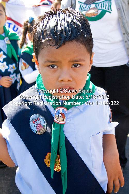 Young Mexican American Cub Scout wearing sash of merit badges in parade. Mexican Independence Day Minneapolis Minnesota MN USA