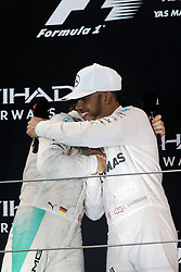 Grand Prix von Abu Dhabi auf dem Yas Marina Circuit / 271116<br /> <br /> ***The podium (L to R): second placed Nico Rosberg (GER) Mercedes AMG F1 celebrates his World Championship with race winner and team mate Lewis Hamilton (GBR) Mercedes AMG F1.<br /> 27.11.2016. Formula 1 World Championship, Rd 21, Abu Dhabi Grand Prix, Yas Marina Circuit, Abu Dhabi, Race Day.<br /> ***