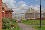 Anti-helicopter netting hangs over the grounds of the prison. HMP The Mount, Bovingdon, Hertfordshire