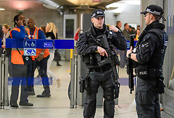 © Licensed to London News Pictures. 16/09/2017. London, UK. Heavily armed police officers on patrol at Westminster Underground station in London, the day after a bomb partly exploded on a tube train at Parsons Green station in London injuring members of the public. Operation temperer has been put in to place after the UK terror threat level was raised to critical. Photo credit: Ben Cawthra/LNP