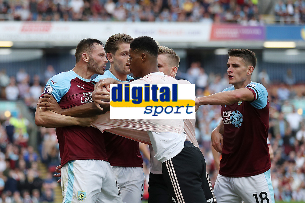 Football - 2018 / 2019 Premier League - Burnley vs. Manchester United<br /> <br /> Phillip Bardlsey of Burnley and Marcus Rashford of Manchester United square up to each other at Turf Moor.<br /> <br /> COLORSPORT/PAUL GREENWOOD