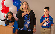 Students recite the pledge during a dedication ceremony at Mark White Elementary School, December 13, 2016.