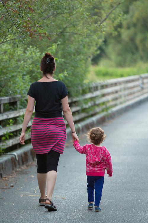 North America, United States, Washington, Kirkland, mother and daugther walking in Juanita Bay Park,