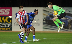 James Hamon of Exeter City claims the ball ahead of Ivan Toney of Peterborough United - Mandatory by-line: Joe Dent/JMP - 04/12/2018 - FOOTBALL - St James Park - Exeter, England - Exeter City v Peterborough United - Checkatrade Trophy