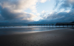 © Licensed to London News Pictures. 10/03/2014<br /> <br /> Saltburn, Cleveland, United Kingdom<br /> <br /> The Victorian pier is bathed in blue early morning light in Saltburn by the Sea in Cleveland.<br /> <br /> Photo credit : Ian Forsyth/LNP