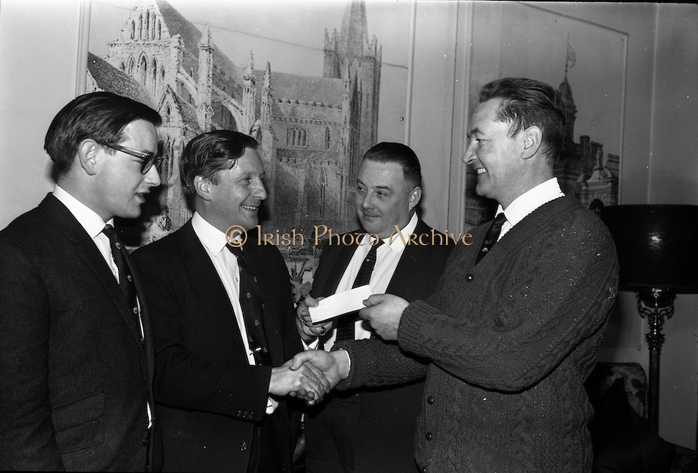 4/3/1965<br /> 3/4/1965<br /> 4 March 1965<br /> <br /> Mr. John D. Pickard Marketing Manager from Beamish and Crawford handed over a cheque to Seanus Kavanagh  for sponsorship of the Irish Judo Team for participation in the European Judo Chapionship which will be held in Madrid. this will be the first time that an Irish team has competed in these championships . also included are Mr. Edmond Veale and Mr Peter Mc.Glynn