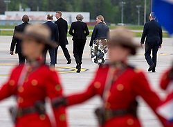 British Prime Minister Theresa May, centre, heads from her aircraft past marching RCMP officers as she arrives in CFB Bagotville, Quebec, Canada for the annual summit of G7 leaders on Thursday, June 7, 2018. The event will be held in La Malbaie, in the Charlevoix region of Quebec. Photo by Andrew Vaughan/CP/ABACAPRESS.COM