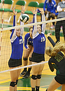 Washington's Kellie Walters (13) and Kirsten Peterson (19) try to block a kill by Hempstead's Karrah Davis (20) during the MVC Volleyball Tournament Championship game between the Hempstead Mustangs and the Washington Warriors at Kennedy High School in Cedar Rapids on Saturday October 13, 2012. Hempstead defeated Washington 25-21 25-19.