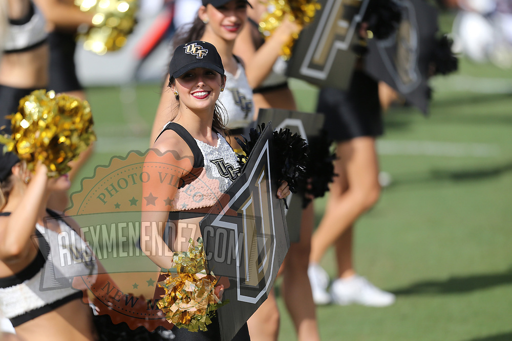 ORLANDO, FL - NOVEMBER 11: A cheerleader is seen on the sideline during a NCAA football game between the University of Connecticut Huskies and the UCF Knights on November 11, 2017 in Orlando, Florida. (Photo by Alex Menendez/Getty Images) *** Local Caption ***